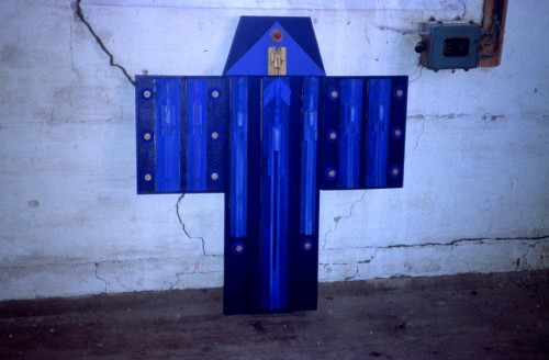 Fotograf: Eget fotoVærk  titel: Transportable altertavler Værk  type: Relief Materiale: Bemalet træ Størrelse: 100x100 cm. Færdiggjort: 1999