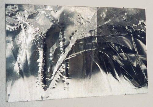 Fotograf: Eget fotoVærk  type: Relief Materiale: Poleret rustfrit stål Størrelse: 100x162 cm Færdiggjort: 1995 Placering: Eget hus