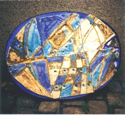 Fotograf: Eget fotoVærk  type: Relief Materiale: Brændt ler m. glasur Størrelse: 60 x 50 cm Færdiggjort: 2000